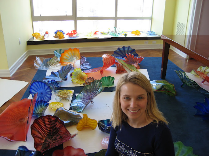 Marisa Mayer surrounded by Chihuly glass